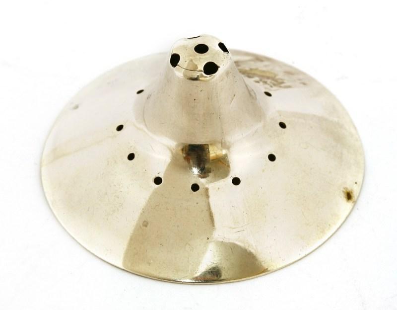 A George III silver nipple shield in the Tim Wonnacott sale at Sworders