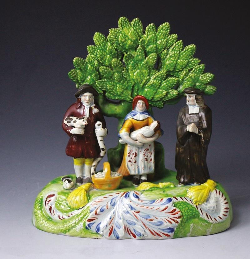 A porcelain figure including pigs