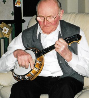 Late collector George Johnson with his George Formby ukulele