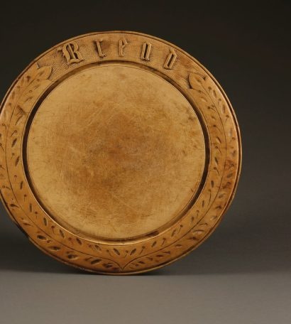 An antique breadboard with gothic font