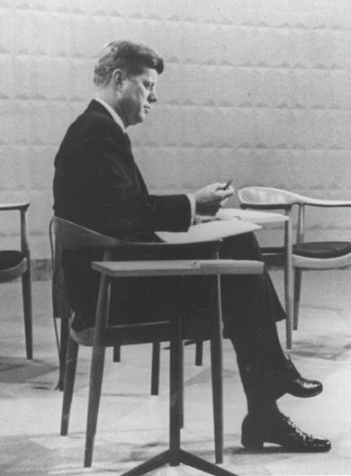 John F Kennedy sitting on Hans J. Wegner's JH501 chair