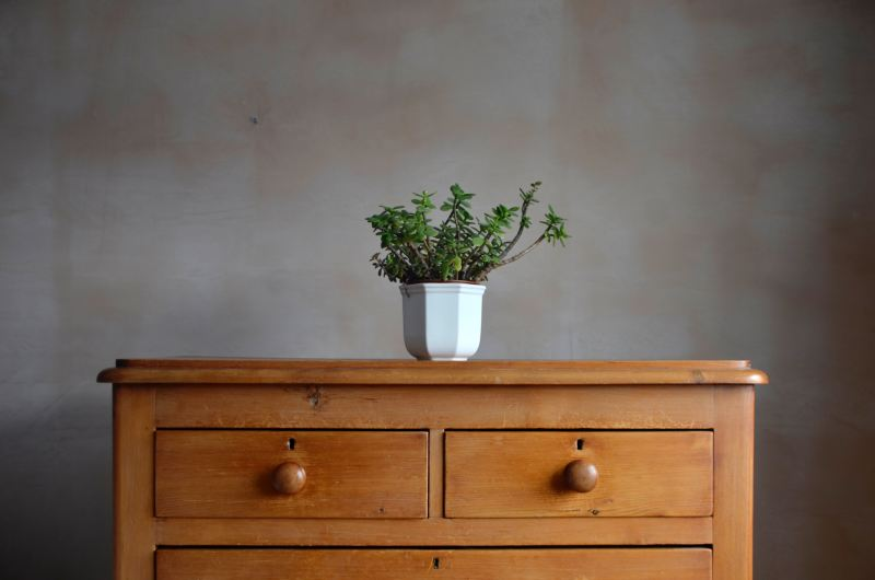 An antique pine chest of drawers