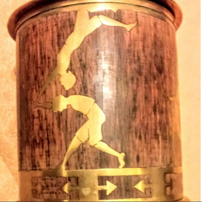 European tea caddy. Acrobatics in brass on wood. #brimfieldantiqueshow. #midcenturymodern #midcenturyteacaddy See us at he Brimfield Antique Show. MAY'S Field, booth #188. Thursday May 10th@ 9am