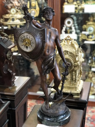 Mercury Ascendant From The Sea antique clock