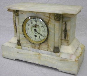 Rare Boston Clock Co. Onyx Temple Form Mantel Clock, c. 1880, tandem wind, with metal mounts and a floral decorated porcelain dial, time and strike, H.- 9 3/4 in., W.- 14 1/4 in., D.- 6 in.