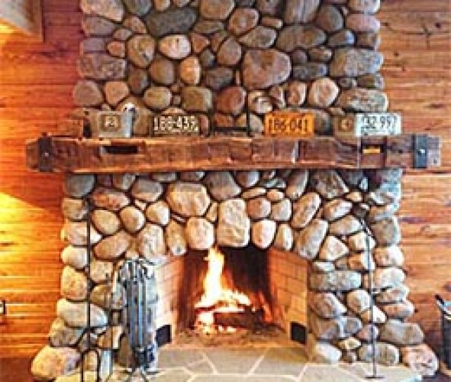 Stone Fireplace With Hewn Mantel