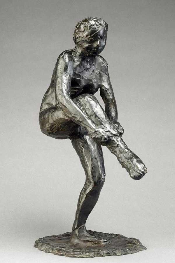 Sculpture danseuse mettent san bas