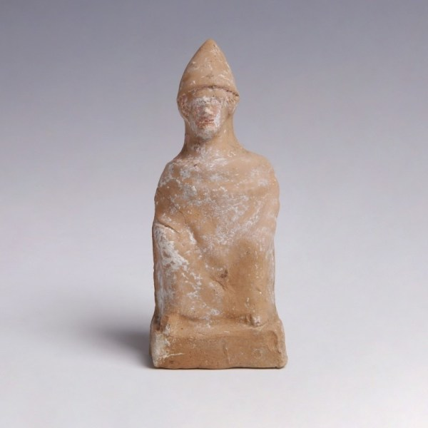 A Greek Terracotta Figurine of a Seated Man