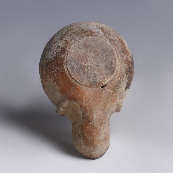 A Roman Oil Lamp with Ithyphallic Man