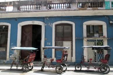 A Centro Havana street scene: Trishaw taxi waiting for customers.