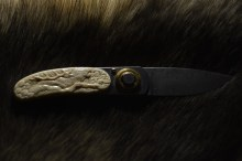 Wolf and Deer Knife (mammoth ivory) by Dmitry Gorodetsky