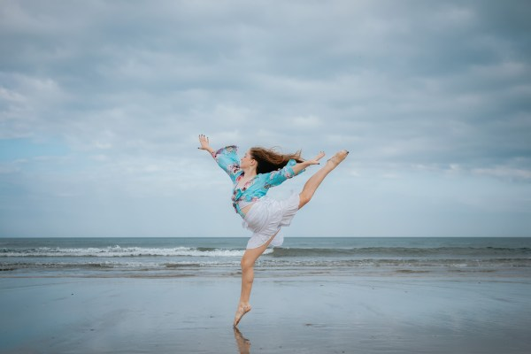 Woman jumping with joy _ Improve your mood