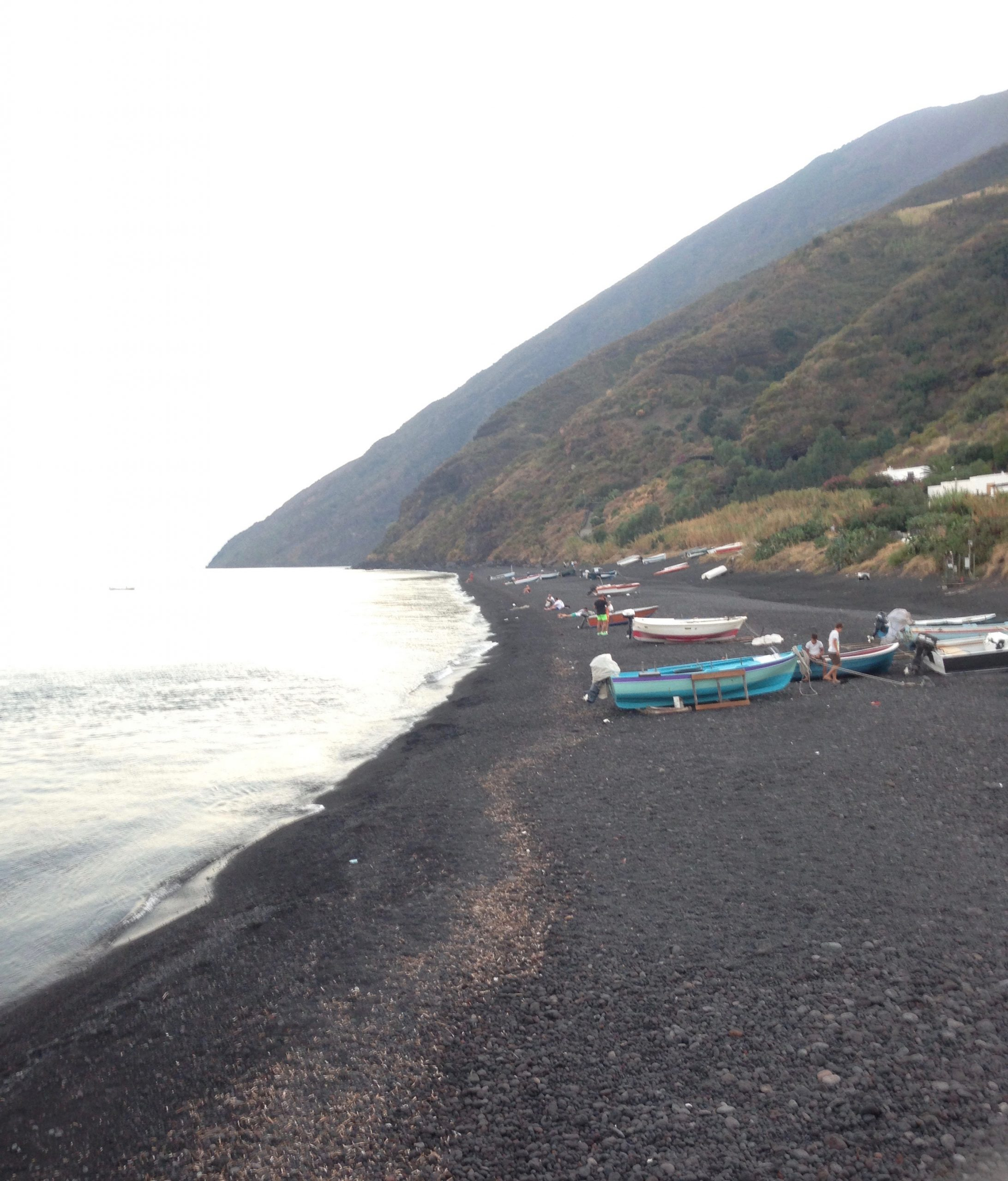 Beach with black sand on the island of Vulcano in Sicily