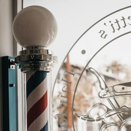 Barber pole inside shop