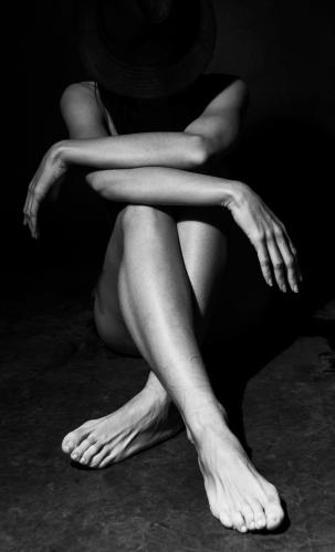 Woman's body in light & shadow