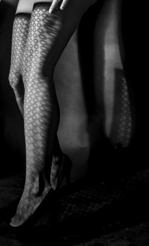 Woman's legs in light & shadow