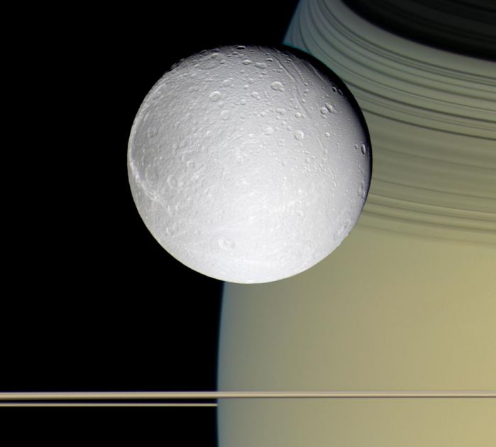 Saturn's moon Dione passes in front of the planet