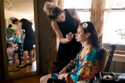Ellery gets makeup on before her Manor House wedding on June 26, 2016, in Littleton, Colorado.