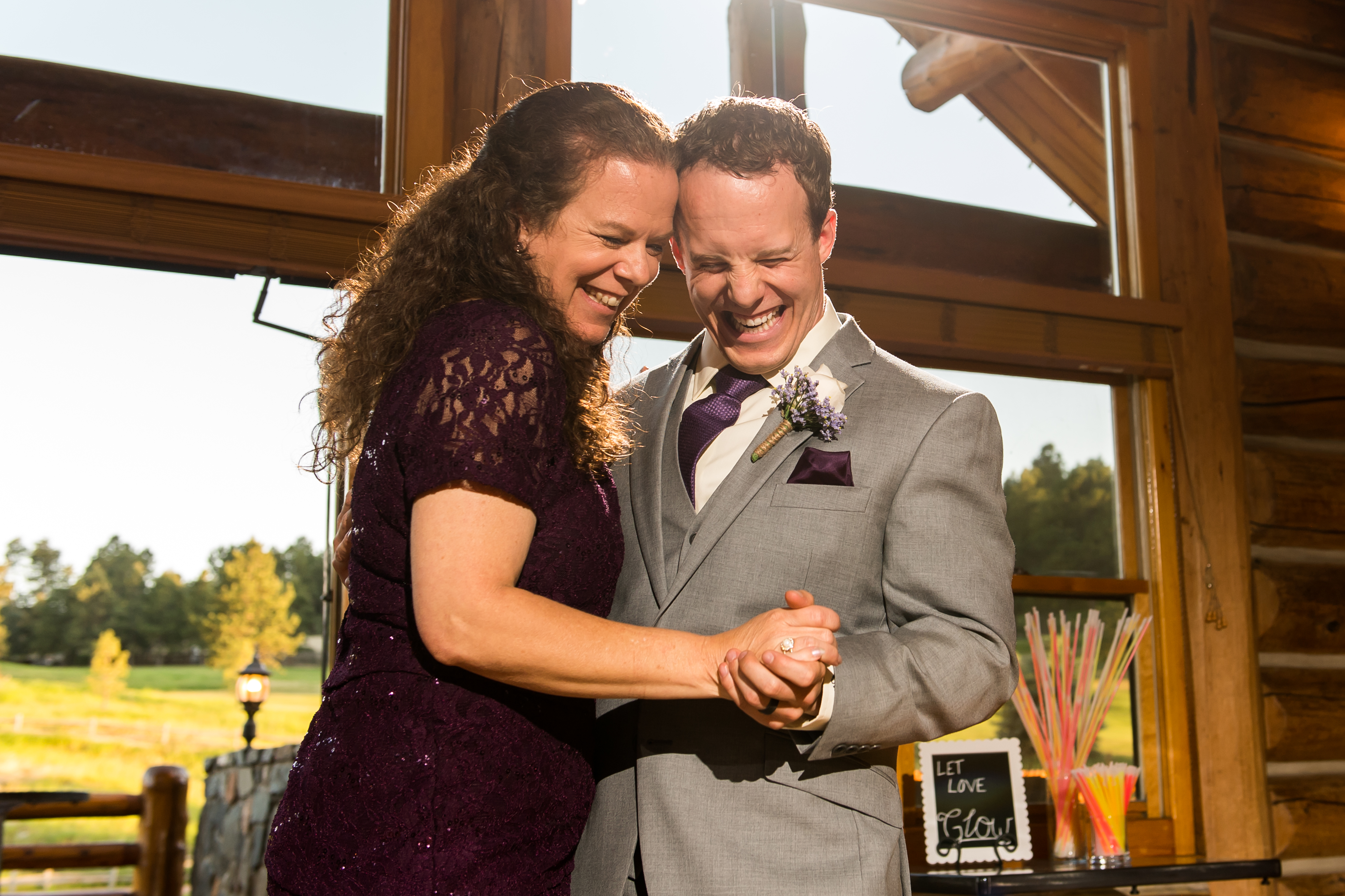 Evergreen Lake House wedding pictures of groom dancing with mother