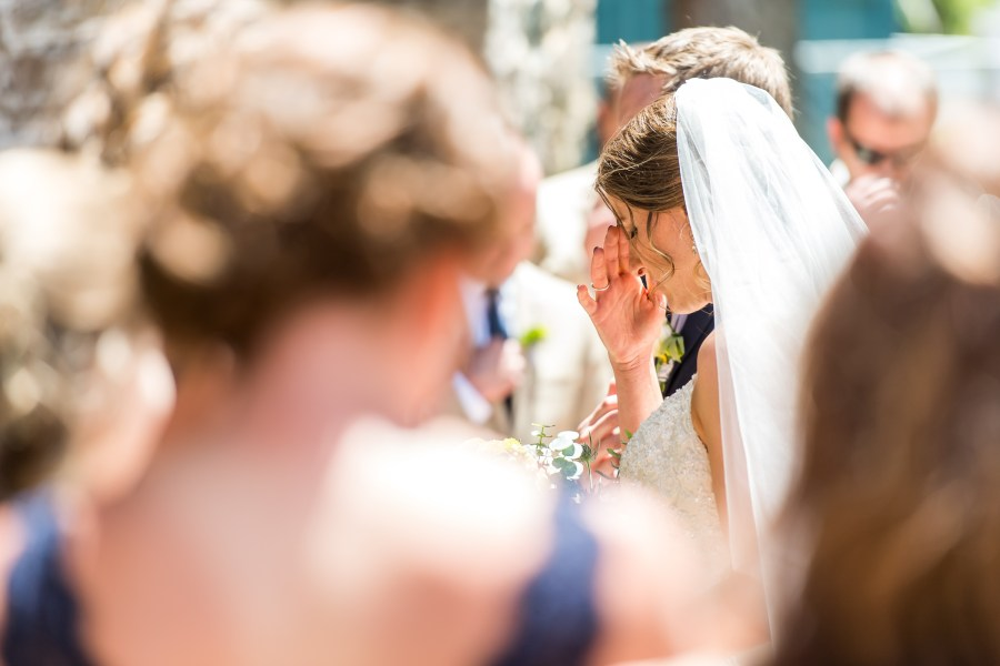 Praying during an Our Lady of Lourdes Denver wedding.