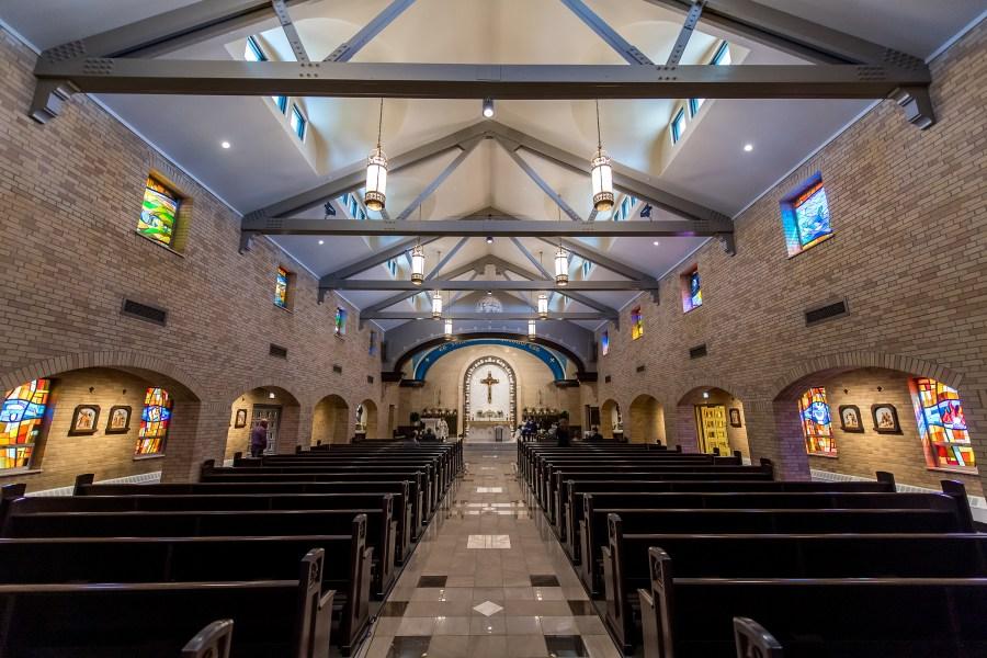 An empty church wedding at Our Lady of Lourdes Catholic Church in Denver, Colorado.