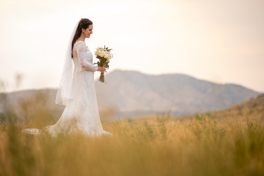 Bride poses during her wedding portrait session at Bear Creek Lake Park in Lakewood, Colorado.