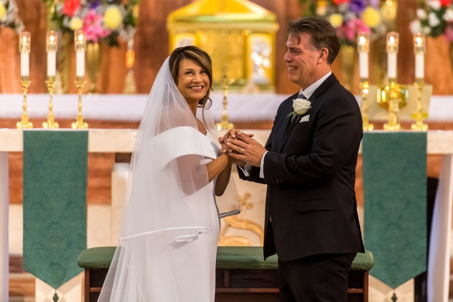 Bride and groom smile after their St. Joseph Catholic Church wedding on August 8, 2020, in Fort Collins, Colorado.