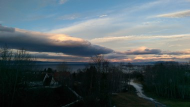 icy sunset over trondheim from bymarka