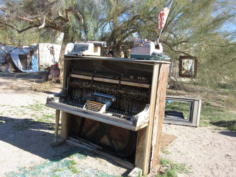 Piano and typewriters at East Jesus sculpture park Slab City CA
