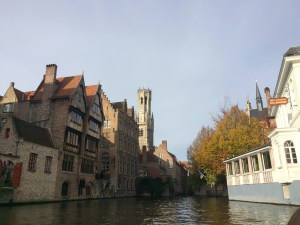 A stunning view from the Canal Boat, you can just see the Belfry in the distance, Bruges