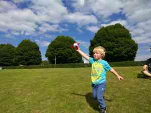 Boy running with plane