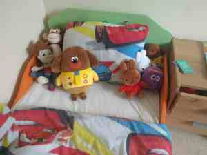 Childs bed with stuffed toys including Hey Duggee
