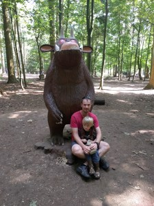 Father and son in front of wooden carved gruffalo