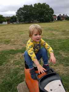Boy on park equipment