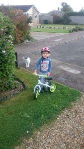Box on his green xootz balance bike