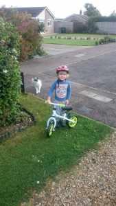 Boy on balance bike