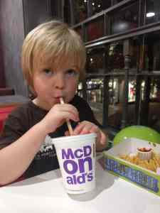 Boy eating McDonalds