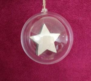 wooden star inside a bauble
