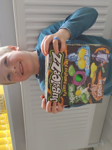 Boy with new Juggleezz toy in box