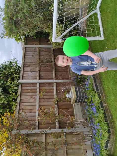 Boy throws ball at camera