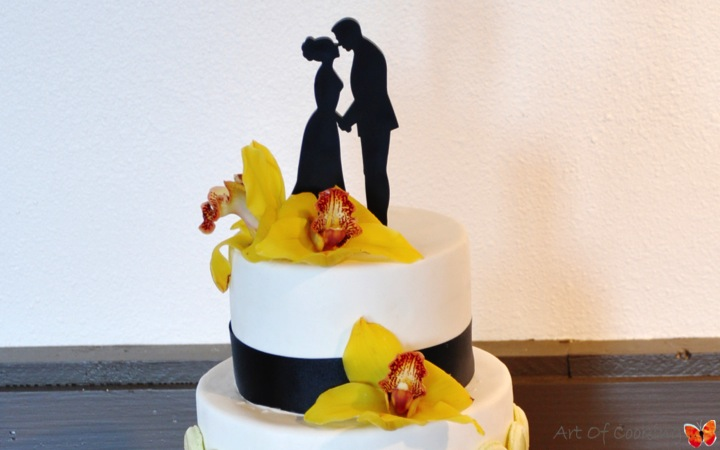 Black And White Wedding Cake With French Macarons And Yellow Orchid Flower Full Service