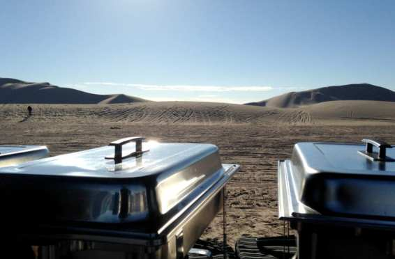 Art Of Cooking specialist of extreme location catering, Ready to serve lunch with a Beautiful backdrop view on the Dumont Dunes Death Valley CA