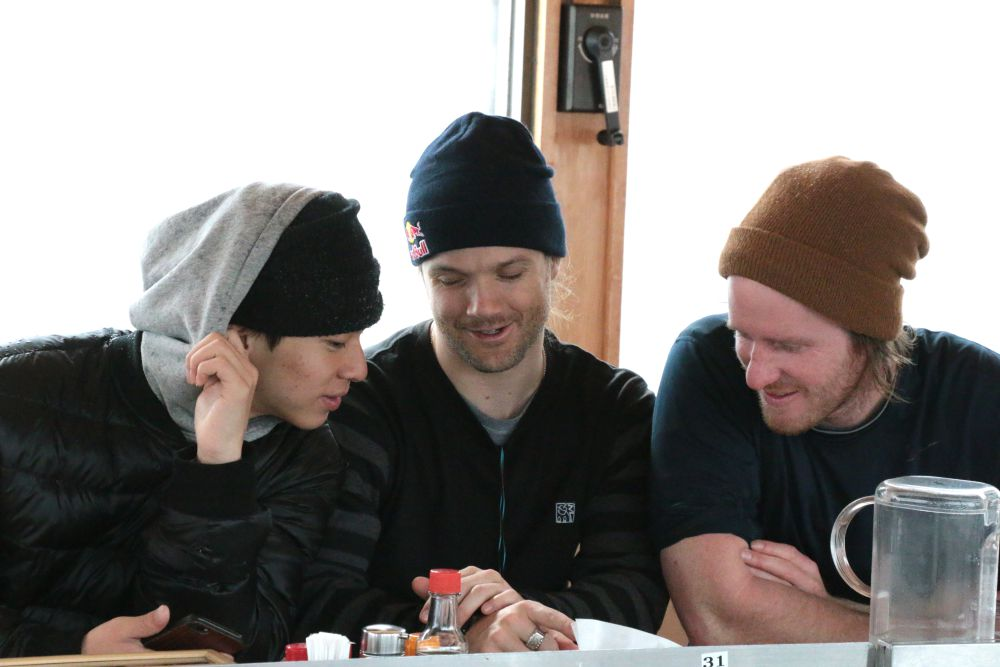 Movement analysis with fellow halfpipe rider, Ayumu Hirano (left), and coach Elijah Teter (right), at the Ramen House locatedat the base of the halfpipe.