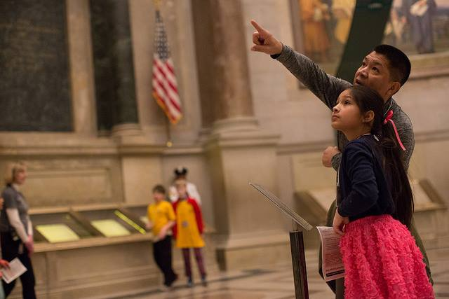 Adult and child in the National Archives Rotunda