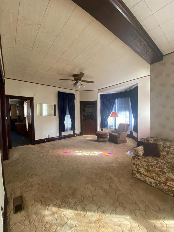 Living room featured at 121 E 12th St, Larned, KS 67550