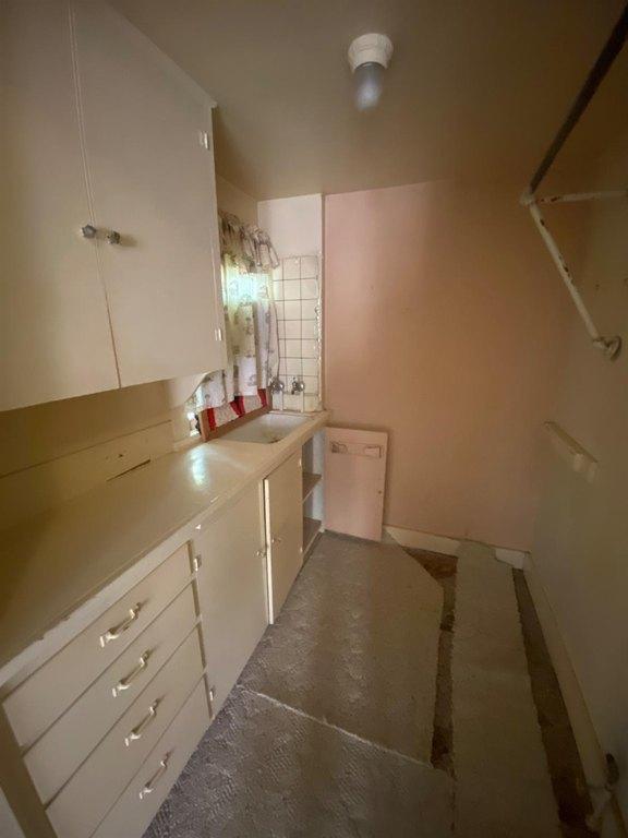 Bathroom featured at 121 E 12th St, Larned, KS 67550