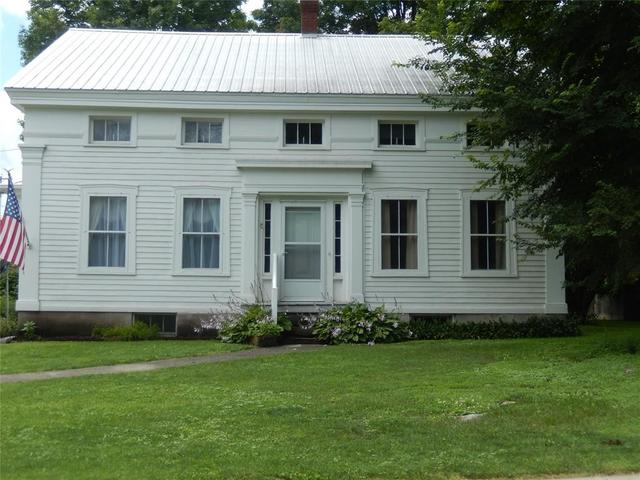 Porch yard featured at 32 Whig St, Newark Valley, NY 13811