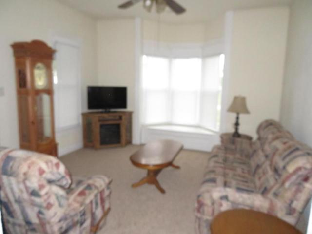Living room featured at 216 S Main St, Afton, OK 74331