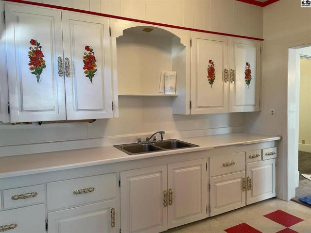 Kitchen featured at 115 S Taylor St, Pratt, KS 67124