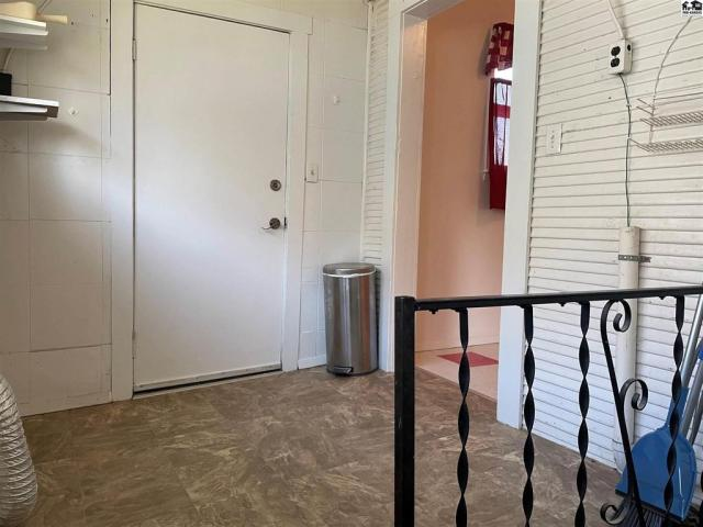 Laundry room featured at 115 S Taylor St, Pratt, KS 67124